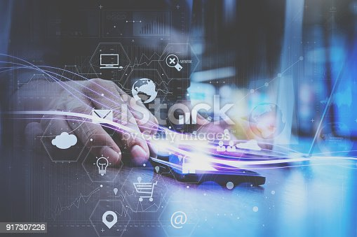 917307226istockphoto businessman hand working with mobile smart phone in modern office with virtual icon diagram 917307226