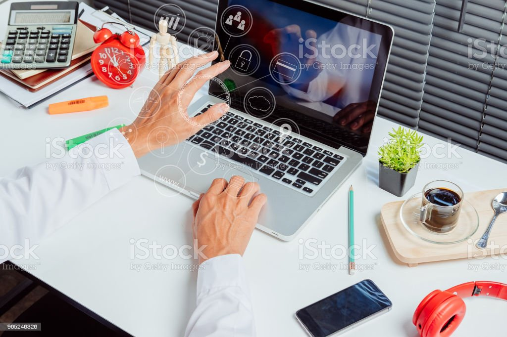 Businessman hand working with modern laptop zbiór zdjęć royalty-free