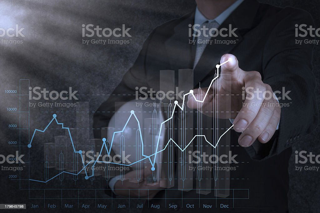 businessman hand working with new computer interface show buildi royalty-free stock photo