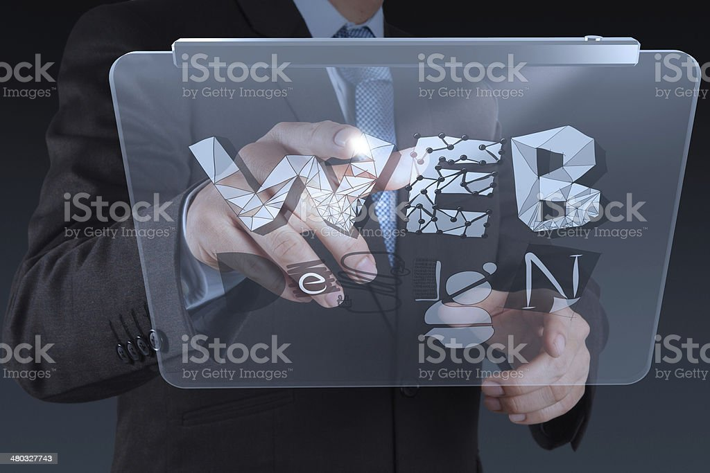 businessman hand working with tablet computer show WEB DESIGN wo stock photo