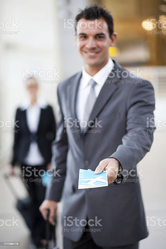 businessman handing over air ticket at airport royalty-free stock photo