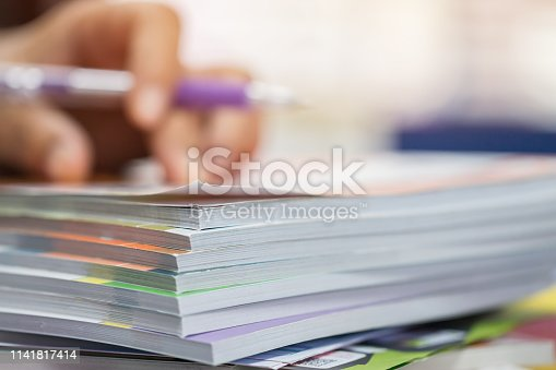 istock Businessman hands checking documents file paperwork financial market, searching information on work busy desk office. Piles of document achieves with pen for sigh. Business report  concept 1141817414