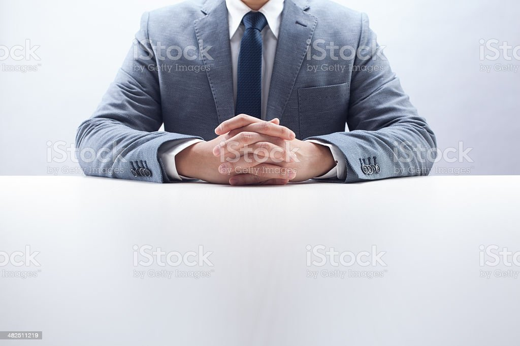 Businessman Hands Folded stock photo