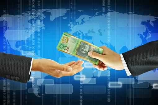 istock Businessman hands giving money - Australian dollars 491703959