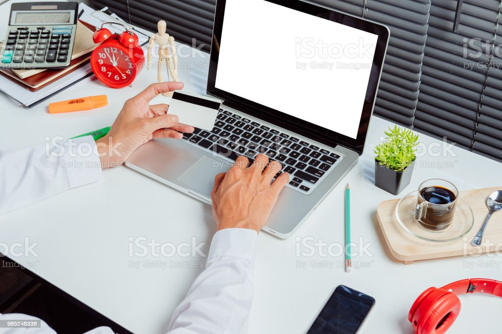 Businessman hands holding a credit card royalty-free stock photo