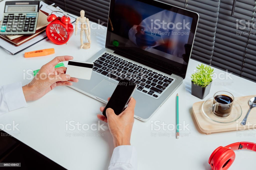 Businessman hands holding smart phone and using credit card royalty-free stock photo