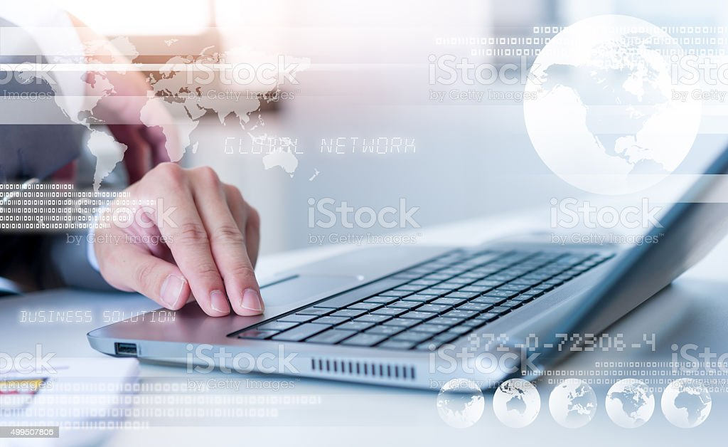 Businessman hands on laptop with technology layer effect, Busine stock photo