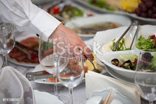 istock Businessman hands taking food in buffet line indoor in luxury hotel 974158242
