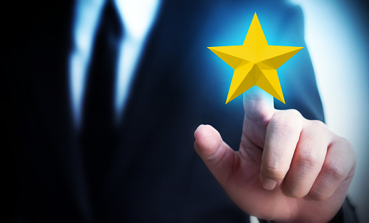 917079212 istock photo Businessman hands touch a five-star gold shape. The best excellent business services rating customer experience concept 1156712459