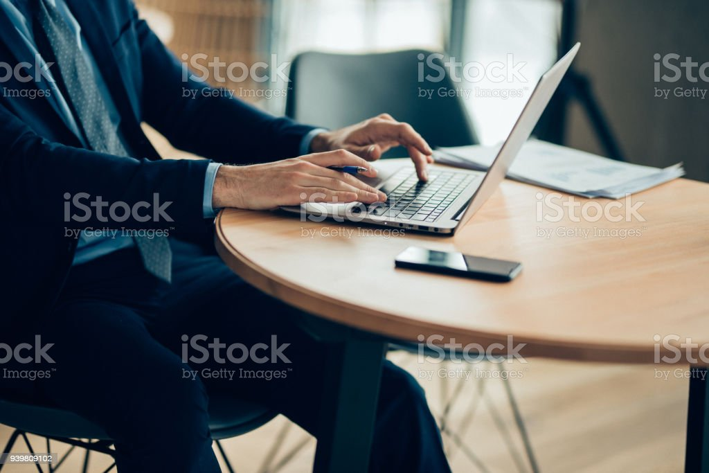 Businessman Hands typing on laptop computer stock photo