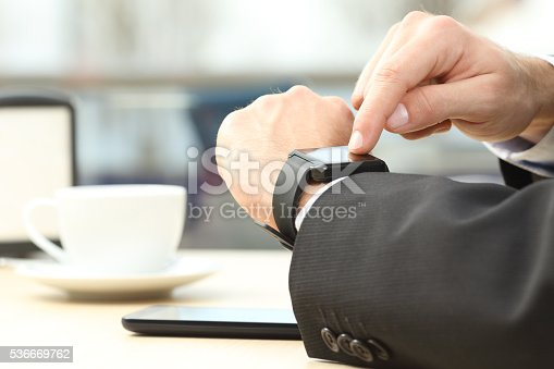 istock Businessman hands using a smart watch 536669762