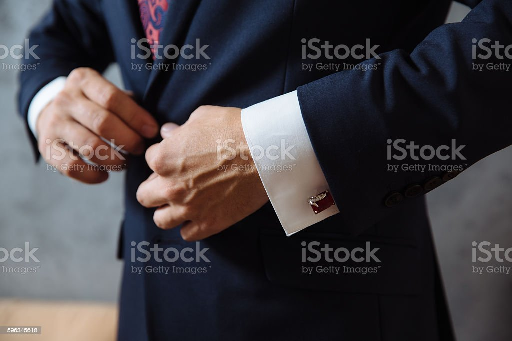 Businessman hands with cufflinks. Elegant gentleman clother royalty-free stock photo
