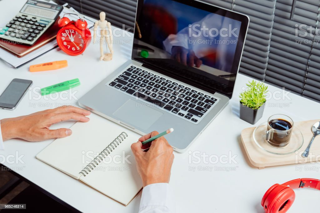 Businessman hands with pen writing notebook royalty-free stock photo