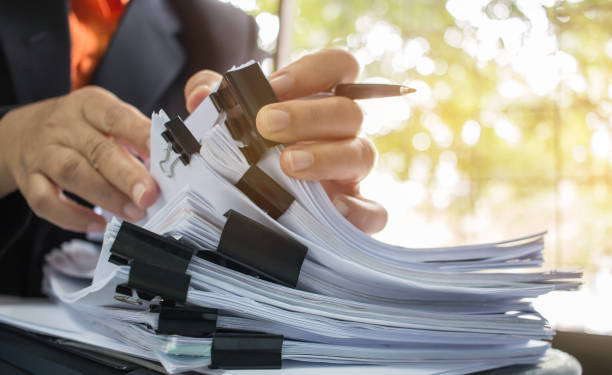 Businessman hands working in Stacks of paper files for searching information on work desk office, business report papers,piles of unfinished documents achieves with clips indoor,Business concept Businessman hands working in Stacks of paper files for searching information on work desk office, business report papers,piles of unfinished documents achieves with clips indoor,Business concept bureaucracy stock pictures, royalty-free photos & images