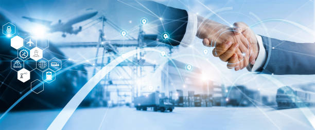 businessman handshake of business deal with logistic  and transportation global network distribution on industrial container terminal, export and import. stock photo