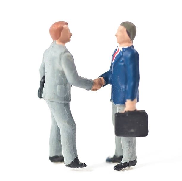 businessman handshake - figurine stock photos and pictures