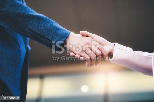 istock Businessman handshake. 917738408