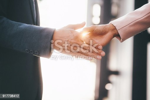 istock Businessman handshake. 917738412