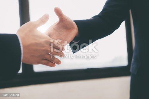 istock Businessman handshake successful contract. 942129670