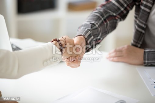 istock Businessman handshaking businesswoman making deal or showing respect, close up 953210734