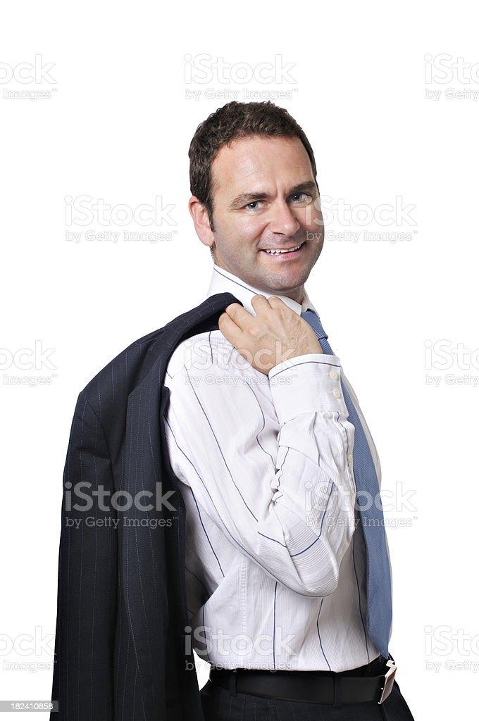 Businessman hanging coat over shoulder stock photo