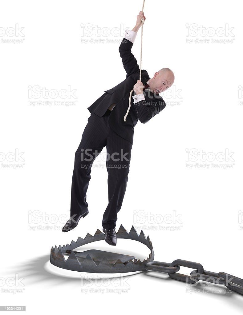 businessman hanging on rope stock photo