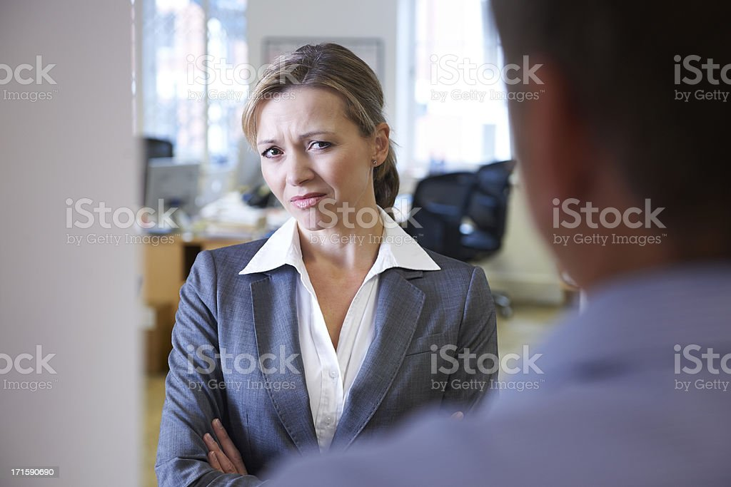 Businessman Harassing Female Colleague stock photo