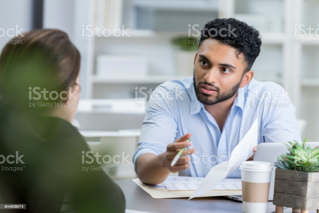 Businessman has a serious discussion with colleague stock photo