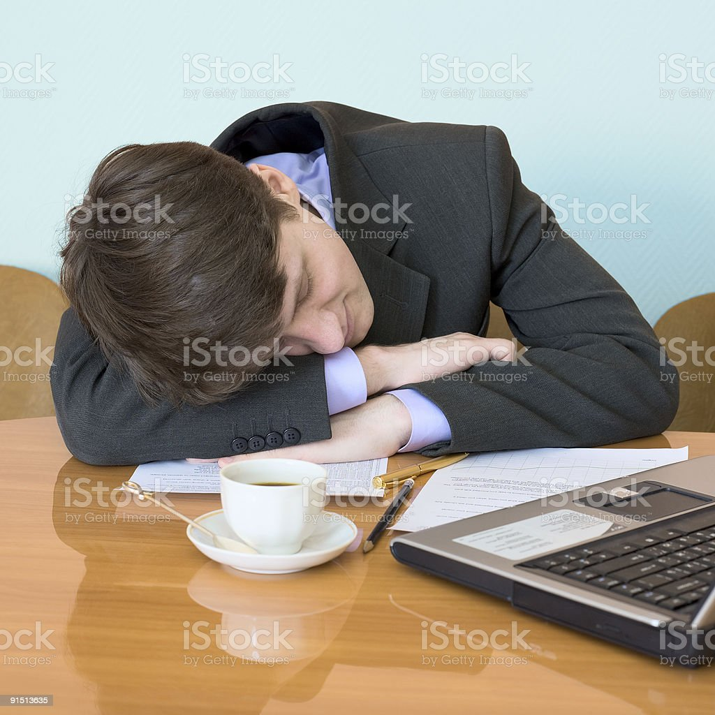 Businessman has fallen asleep sitting at meeting royalty-free stock photo
