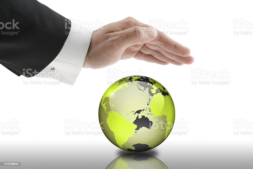 A businessman has his hand over a globe royalty-free stock photo