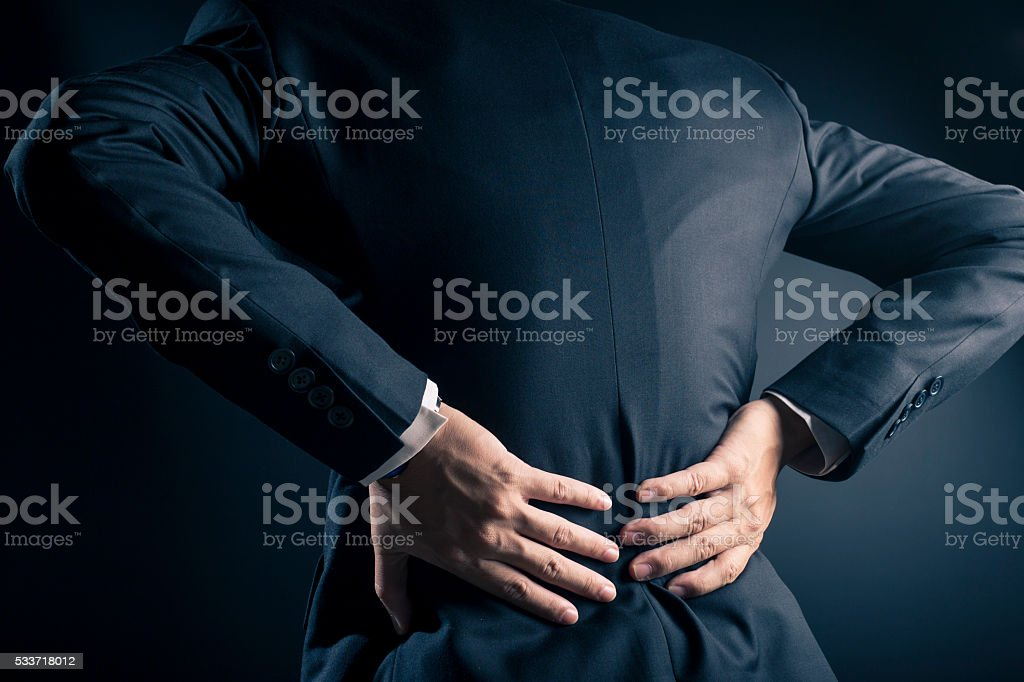 Businessman has waist ache stock photo