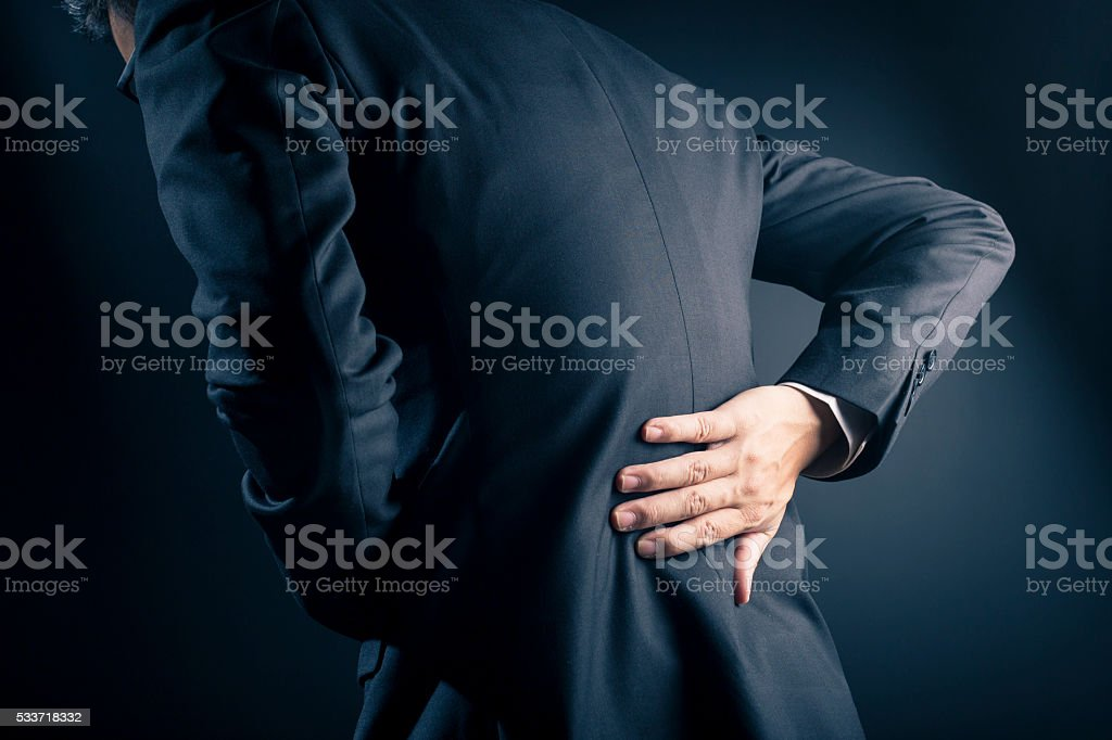 Businessman has waist ache stock photo
