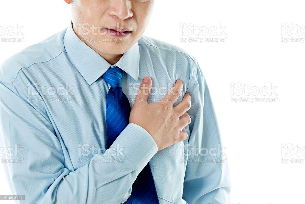 Homme d'affaires ayant une crise cardiaque  photo libre de droits