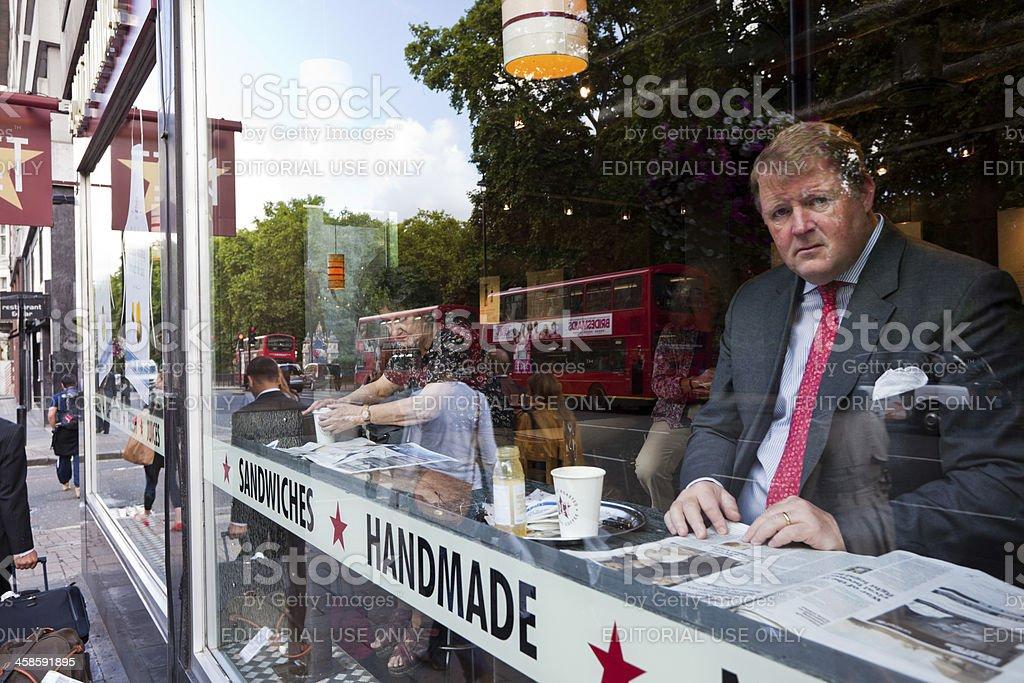 Businessman Having Break at Pret a Manger Store, London royalty-free stock photo