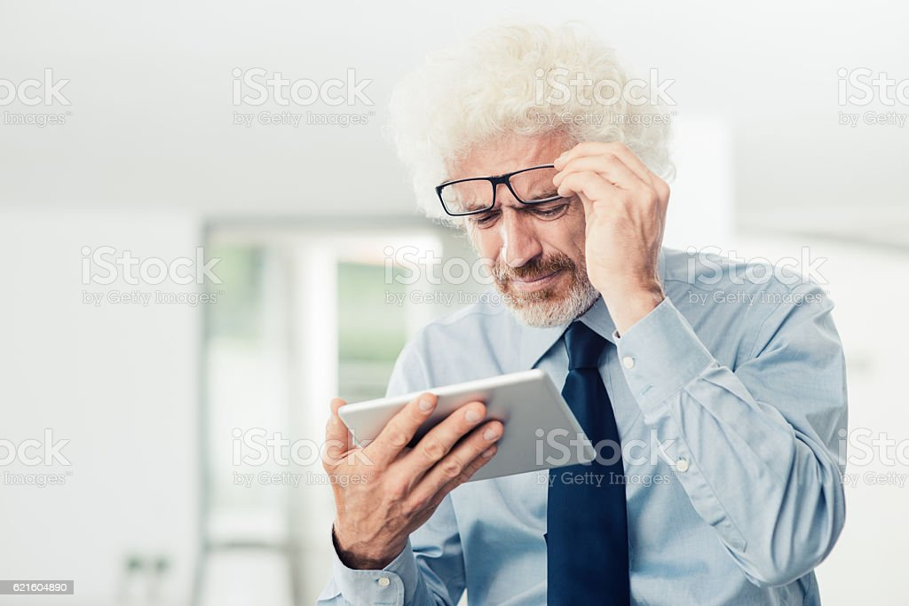 Businessman having eyesight problems stock photo