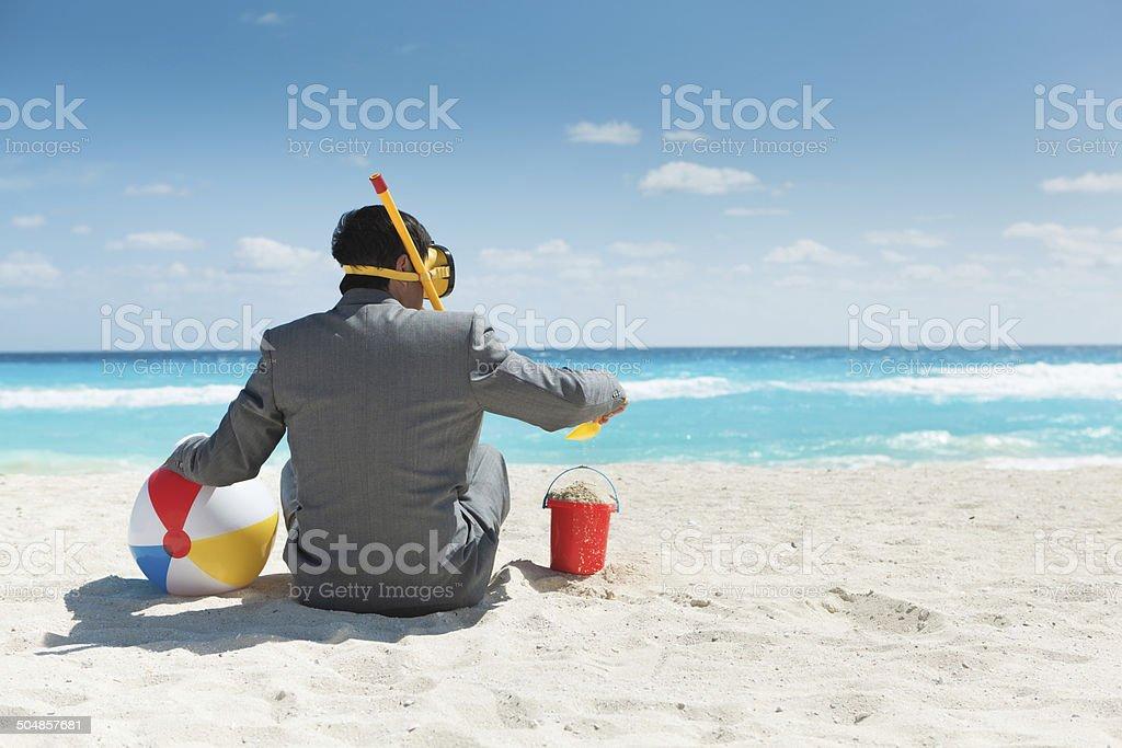 Businessman Having Fun Enjoying Vacation in Tropical Beach Hz royalty-free stock photo