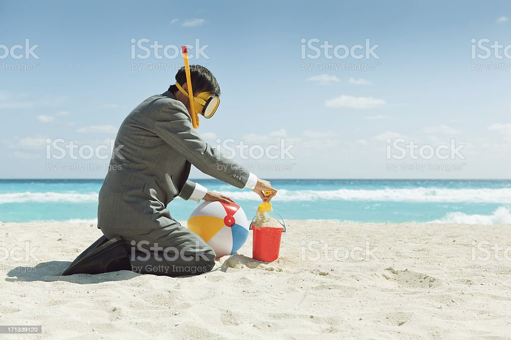 Businessman Having Fun Enjoying Vacation in Tropical Beach royalty-free stock photo