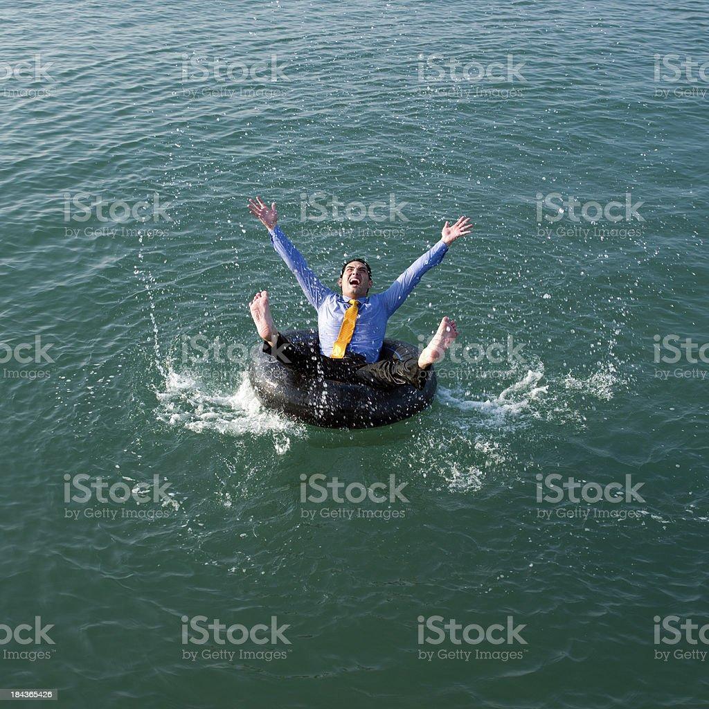 Businessman having fun in the sea royalty-free stock photo