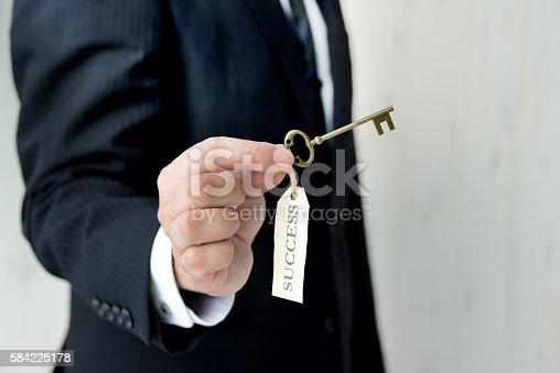 istock Businessman having key to success 584225178