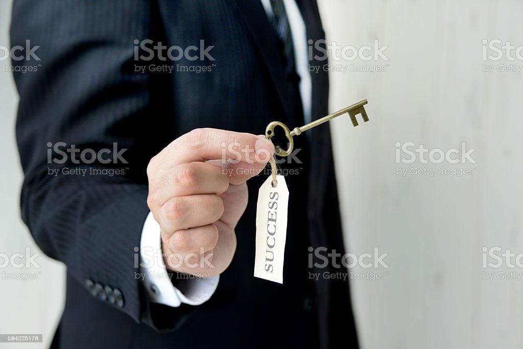Businessman having key to success stock photo