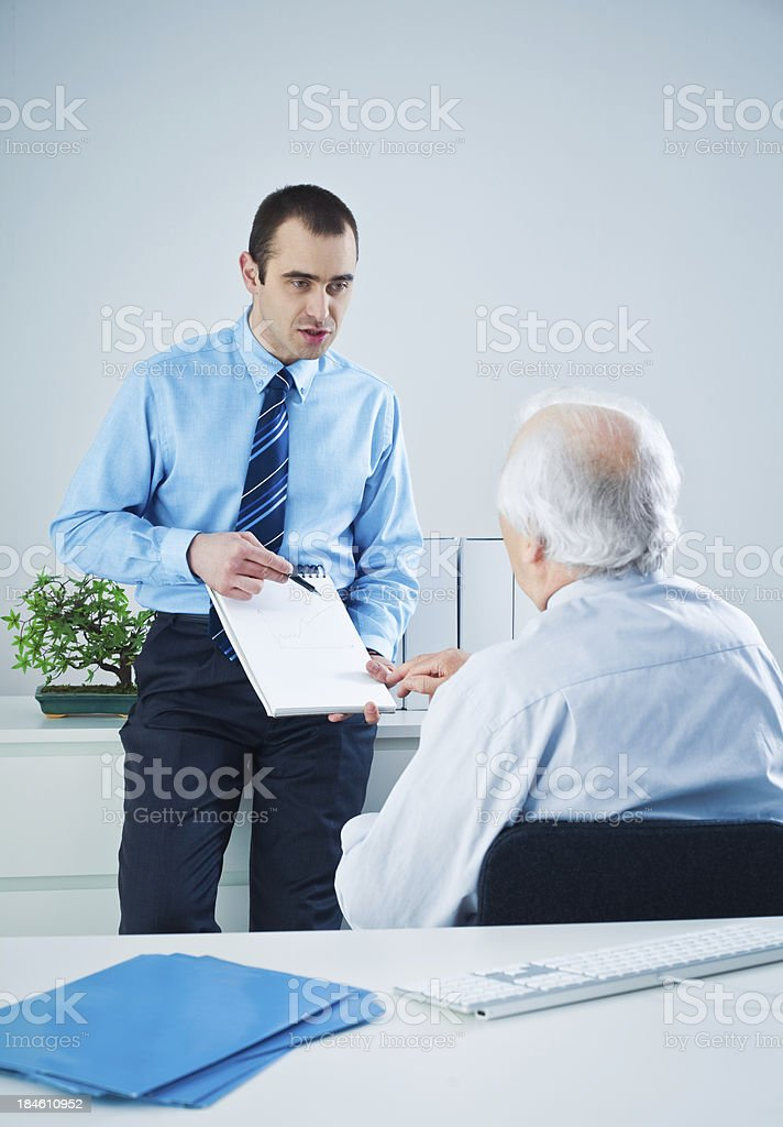 Businessman having meeting with his boss royalty-free stock photo