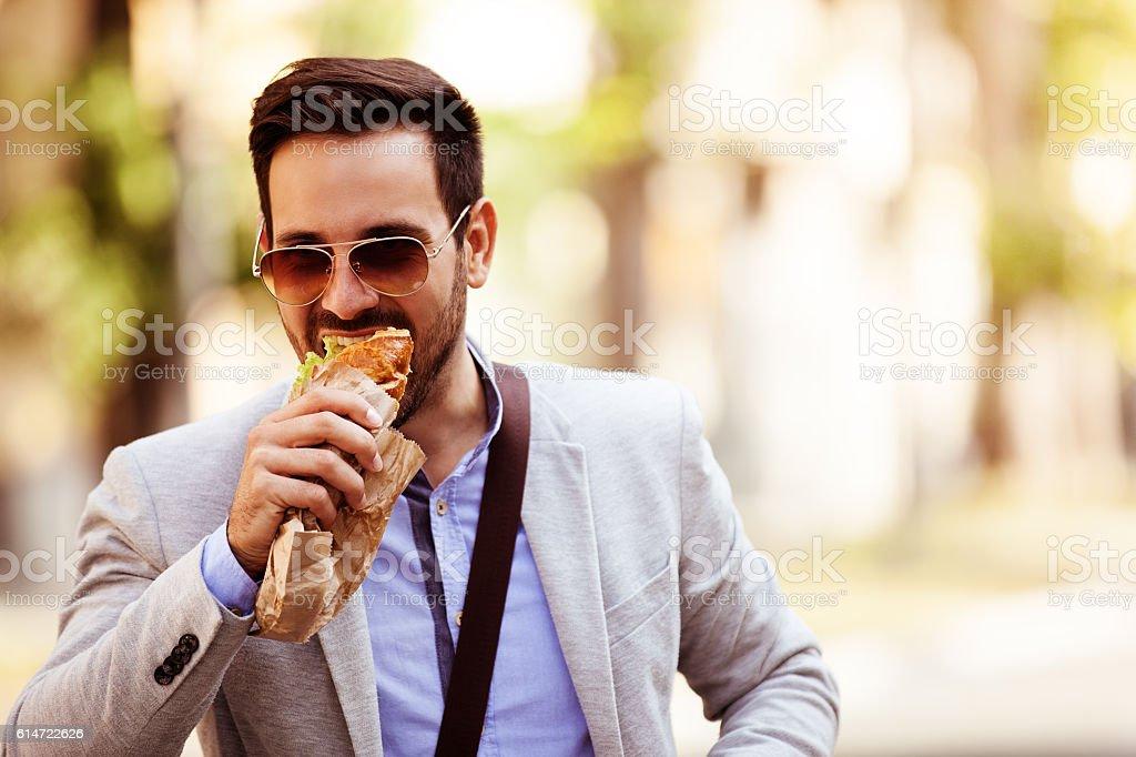 Businessman having snack stock photo