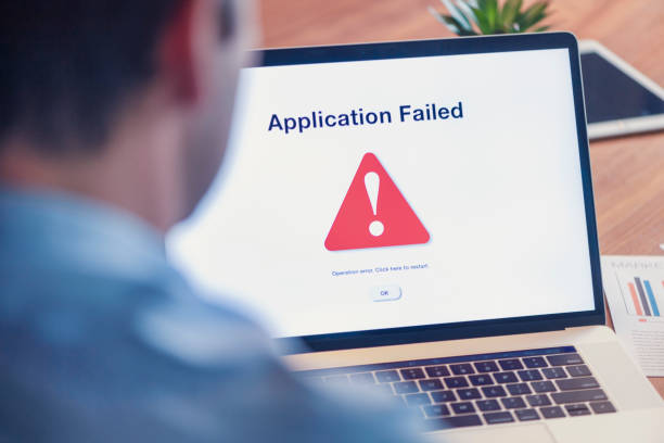 Businessman having trouble with computer. Businessman having trouble with computer. Application failed message error message stock pictures, royalty-free photos & images