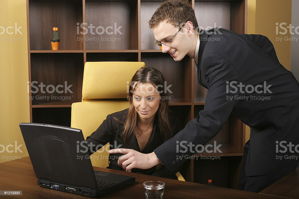 Businessman helping his colleague royalty-free stock photo