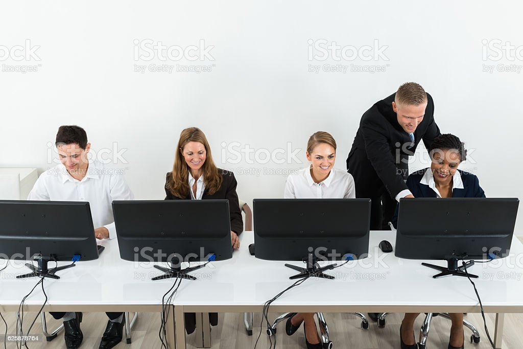 Businessman Helping His Colleagues In The Office stock photo