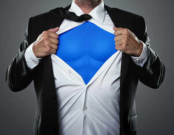 businessman hero - shirt stock photos and pictures