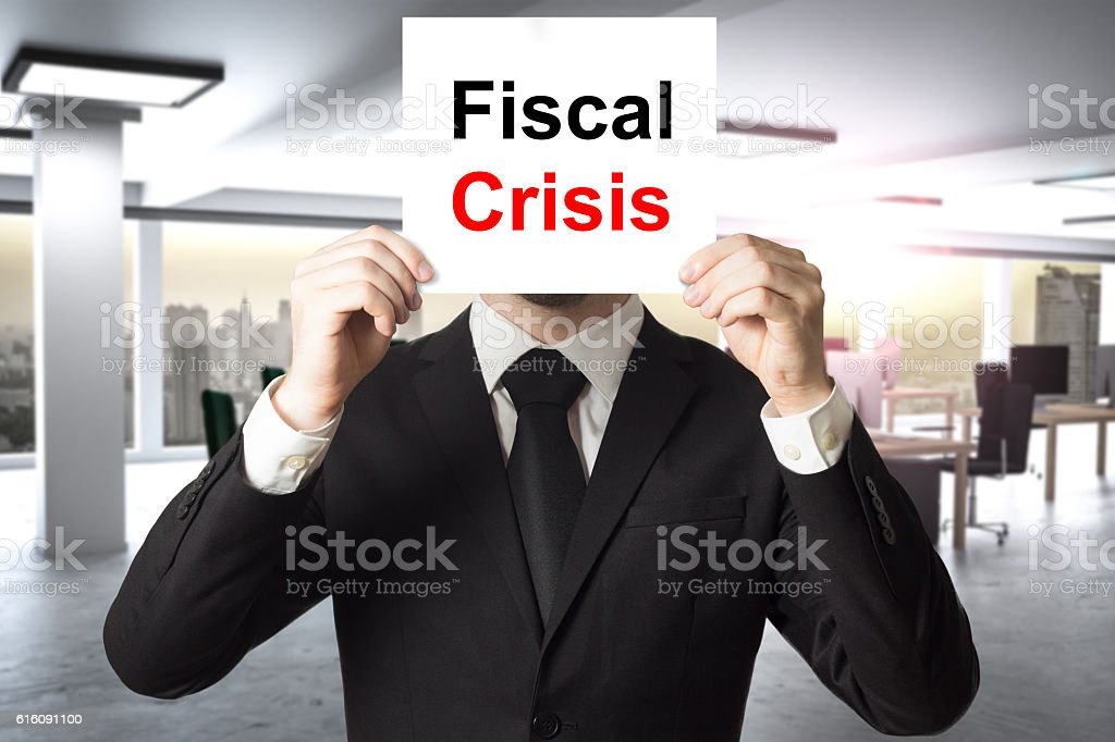businessman hiding face behind sign fiscal crisis stock photo