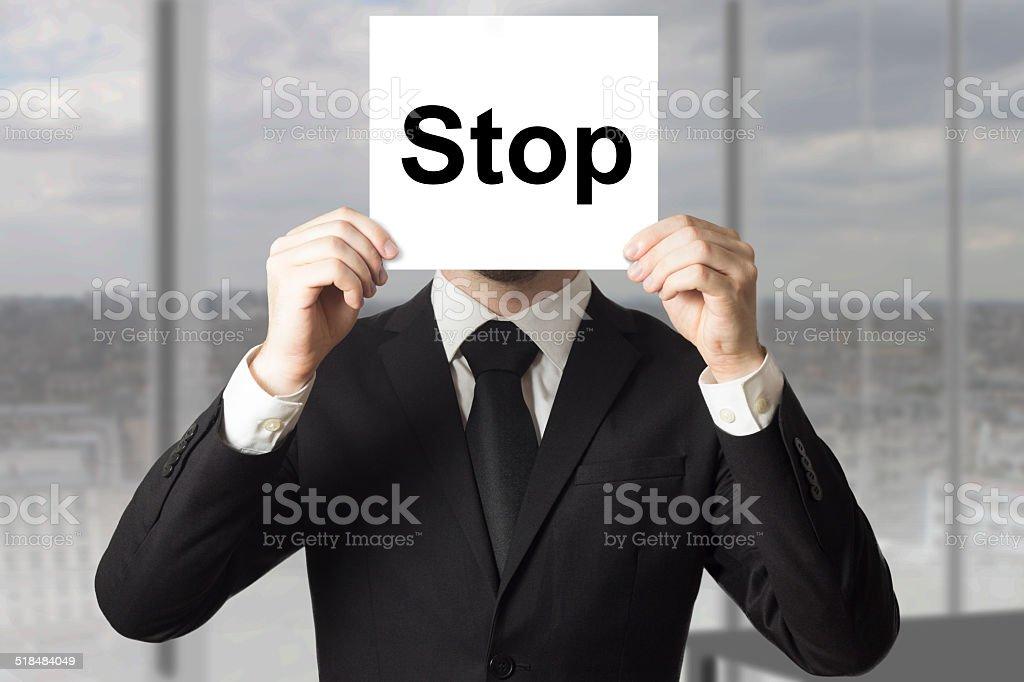 businessman hiding face stop stock photo
