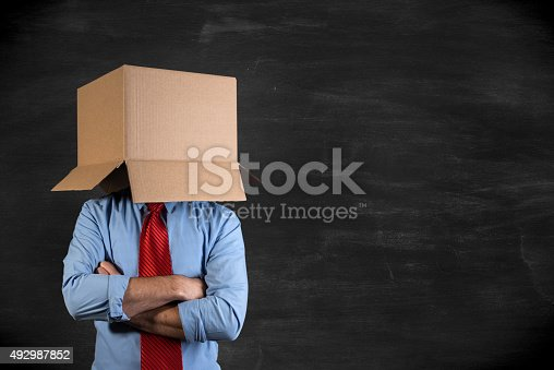 istock Businessman hiding his head in a cardboard box 492987852
