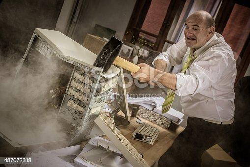 593328060 istock photo Businessman hitting hammer on CPU 487072318